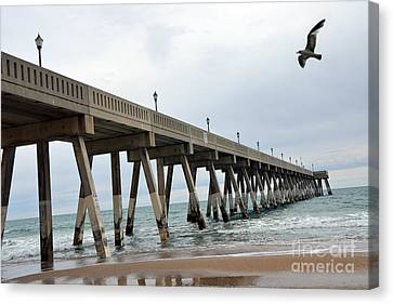 Seagull Flying Canvas Print - Surreal Ocean Coastal Fishing Pier Seagull Wrightsville Beach North Carolina Fishing Pier by Kathy Fornal