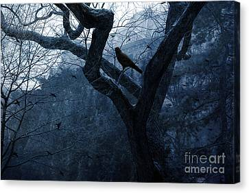 Surreal Gothic Crow Haunting Tree Limbs - Haunting Sapphire Blue Trees  Canvas Print by Kathy Fornal