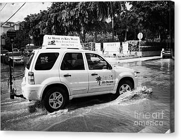 Suv Driving Through Streets Flooded By Heavy Rainfall Key West Florida Usa Canvas Print