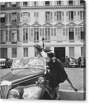 Suzy Parker Outside The French Vogue Office Canvas Print by Jacques Boucher