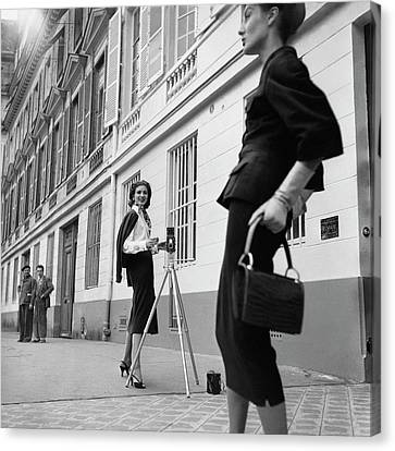 Suzy Parker Photographing A Model In Front Canvas Print by Jacques Boucher