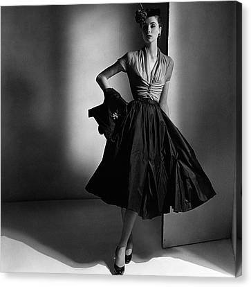 Suzy Parker Wearing A Dior Dress And Jacket Canvas Print by Horst P. Horst