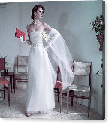 Suzy Parker Wearing A Gown By Christian Dior Canvas Print by Frances Mclaughlin-Gill