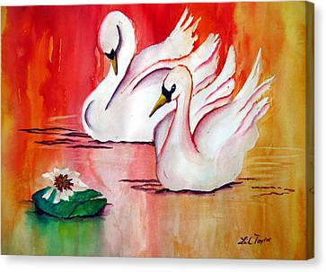 Swans In Love Canvas Print by Lil Taylor
