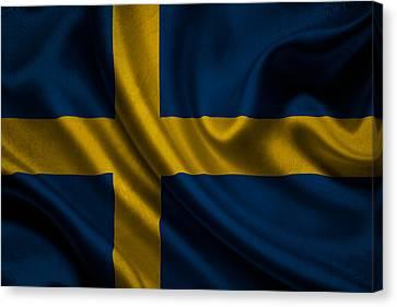 Swedish Flag Waving On Canvas Canvas Print by Eti Reid