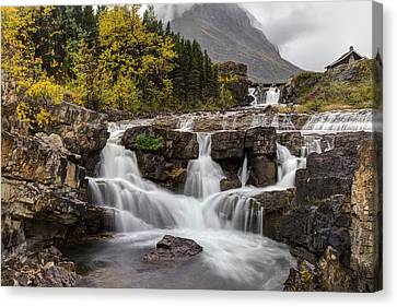 Swiftcurrent Falls In Autumn Canvas Print by Mark Kiver