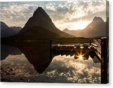 Swiftcurrent Lake Boats Reflection And Flare Canvas Print by John Daly