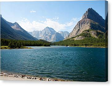 Swiftcurrent Lake Canvas Print by John M Bailey