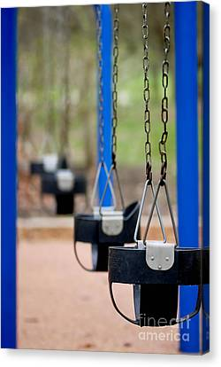 Swings In A Row Shallow Dof Canvas Print