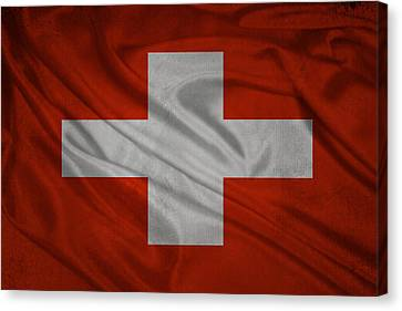 Swiss Flag Waving On Aged Canvas Canvas Print by Eti Reid