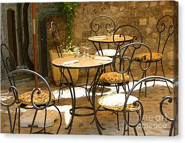 Tables And Chairs Canvas Print by Holly C. Freeman