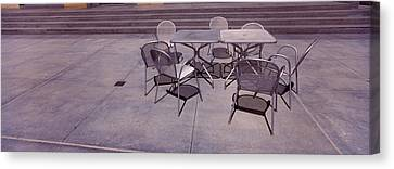 Tables With Chairs On A Street, San Canvas Print by Panoramic Images