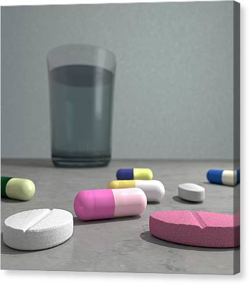 Tablets And Glass Of Water Canvas Print by Robert Brook