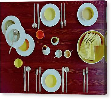 Tableware Set On A Wooden Table Canvas Print by Romulo Yanes