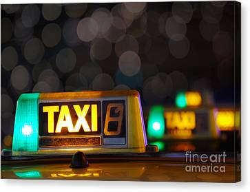 Taxi Signs Canvas Print by Carlos Caetano