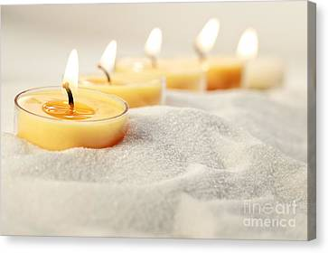 Tea Light Candles In Sand Canvas Print by Sandra Cunningham