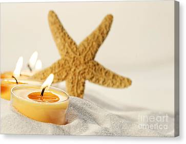 Canvas Print featuring the photograph Tea Light Candles In Sand With Star Fish by Sandra Cunningham