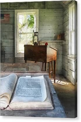 School Houses Canvas Print - Teacher - One Room Schoolhouse With Book by Susan Savad