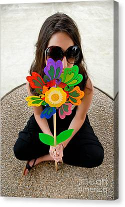 Teenage Girl Hiding Behind Toy Flower Canvas Print by Amy Cicconi