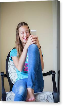 Teenage Girl Using Smartphone Canvas Print