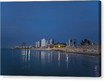 Canvas Print featuring the photograph Tel Aviv The Blue Hour by Ron Shoshani