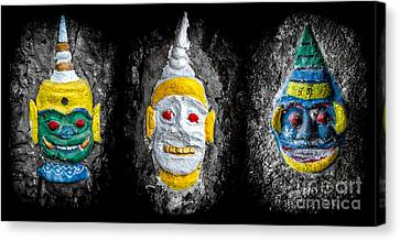 Temple Faces Canvas Print by Adrian Evans