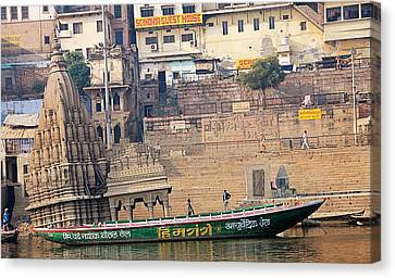 Temple On Boat Canvas Print by Money Sharma