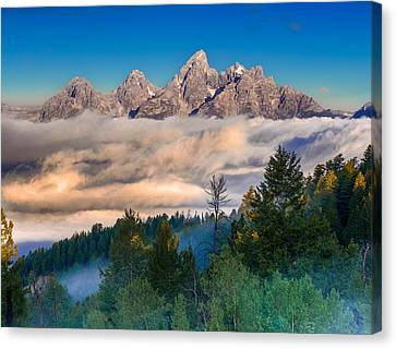 Tetons Above The Clouds Canvas Print by Jerry Patterson