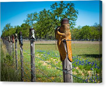 Texas Boot Fence Canvas Print by Inge Johnsson