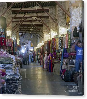 Textile Bazaar Canvas Print by Paul Cowan