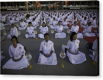 Thai Women Pray For Peace Canvas Print by David Longstreath