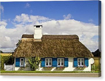 Thatched Country House Canvas Print by Heiko Koehrer-Wagner