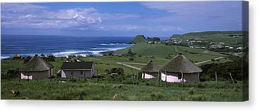 Thatched Roofed Rondawel Huts Canvas Print by Panoramic Images