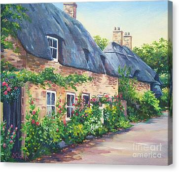 Thatched Roofs Canvas Print by John Clark