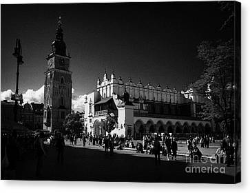 The 16th Century Cloth Hall Sukiennice Building And 13th Century  Gothic Town Hall Tower With Tourists In Rynek Glowny Town Square Krakow Canvas Print