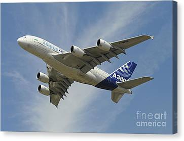 The Airbus A380 Prototype In Flight Canvas Print by Riccardo Niccoli
