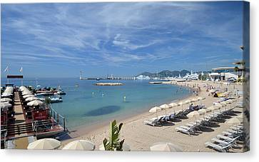 Canvas Print featuring the photograph The Beach At Cannes by Allen Sheffield