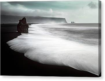 The Black Beach Canvas Print by Liloni Luca