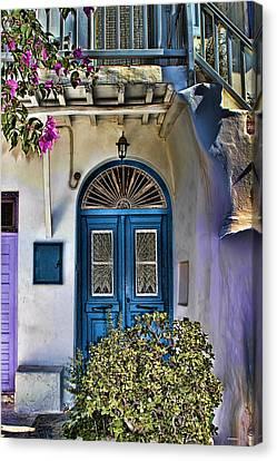 The Blue Door-santorini Canvas Print by Tom Prendergast