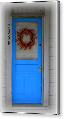 The Blue Door With Bittersweet Wreath Canvas Print by Kathy Barney
