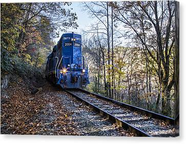 The Blue Train Canvas Print by Debra and Dave Vanderlaan