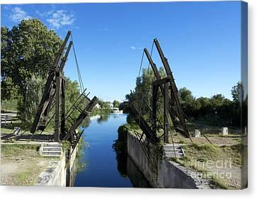 The Bridge At Langlois Painted By Van Gogh. Arles. France Canvas Print by Bernard Jaubert