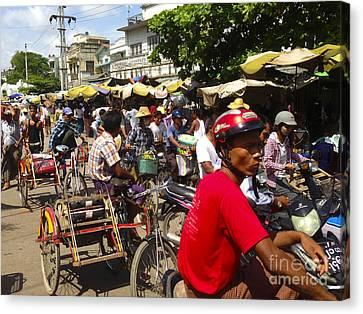 Canvas Print featuring the photograph The Bustling Traffic On 27th Street Zay Cho Street Market Mandalay Burma by Ralph A  Ledergerber-Photography