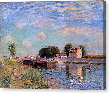 The Canal At Saint-mammes Canvas Print by Alfred Sisley