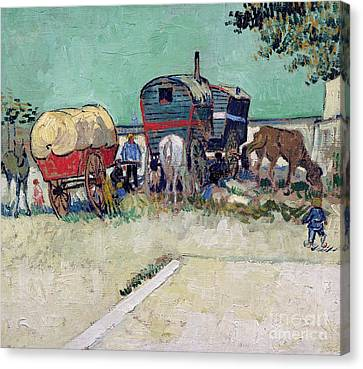 The Caravans   Gypsy Encampment Near Arles Canvas Print by Vincent Van Gogh