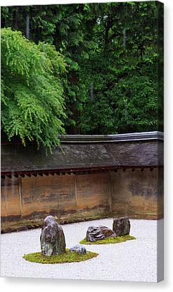 The Carefully Placed Rocks And Raked Canvas Print by Paul Dymond