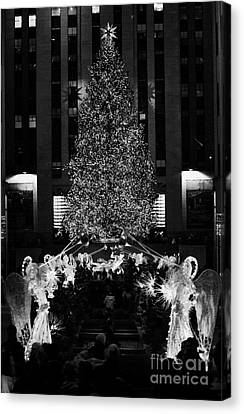 The Christmas Tree Lit Up At Night At The Rockefeller Centr New York City Canvas Print by Joe Fox