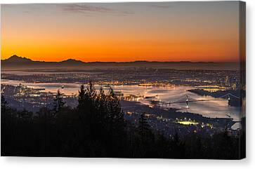 The City Awakens Canvas Print by Ian Stotesbury