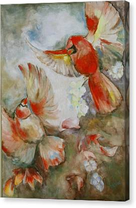 The Dance Of The Cardinals Canvas Print by Susan Hanlon