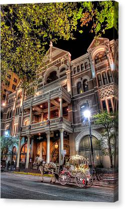 Canvas Print featuring the photograph The Driskill Hotel by Tim Stanley